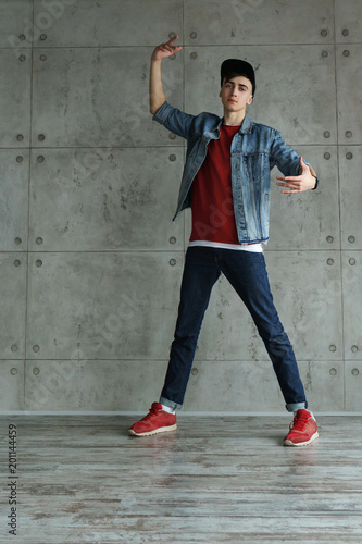 Teenager Guy In Denim Jacket And Baseball Cap Jeans And Red Sweater