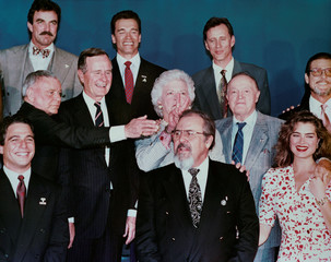 U.S. first lady Barbara Bush gestures during a photo shoot with celebrities at a party in Los Angeles