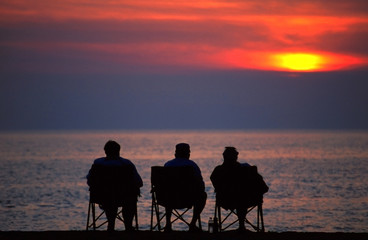 Silhouette of Retired People Watching the Sunset