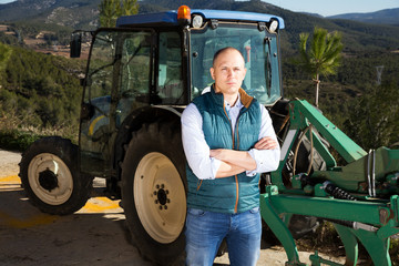 Man near tractor in vineyard