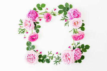 Floral frame made of pink roses and peonies on white background. Flat lay, Top view. Copy space composition