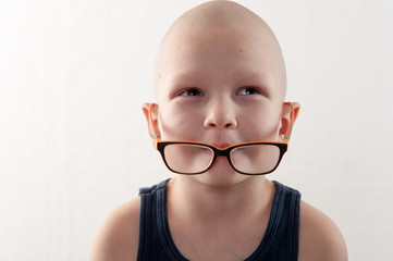 bald, charming child plays with his older brother's glasses