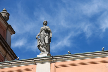 Antique statue on facade of Governor Palace in Piacenza, Italy