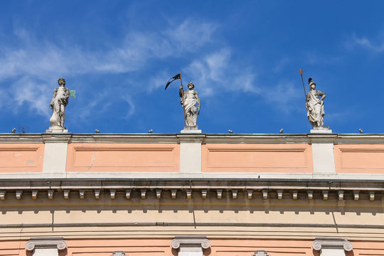 Antique statues on facade of Governor Palace in Piacenza, Italy