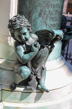 Bronze baby at base of Alessandro Farnese monument, Duke of Parma. Piacenza, Italy