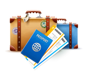 Retro suitcases, passport and airline tickets for travel.