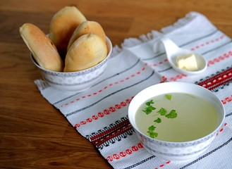 Chicken soup broth. Served with patties with green onions and egg