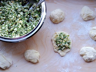 Preparation of homemade yeast pies with green onion and eggs filling