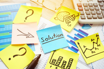 Question marks and arrows to word solution. Solving of problems in business.