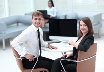 smiling member of the business team sitting at Desk
