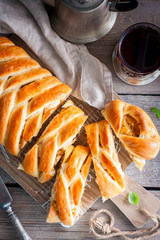 Traditional for Russian cuisine pie with cabbage - Kulebyaka, selective focus, top view