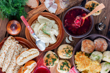 Covered table with traditional Ukrainian food, top view, horizontal