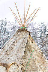 wigwam or teepee standing in winter forst