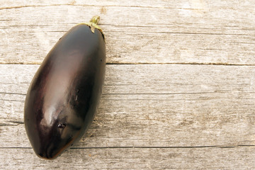 Top view on ripe eggplant. Vegetables on wooden table. Copy space