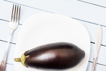 Fresh eggplant from rural garden on wooden table. Copy space. Healthy organic nutrition concept