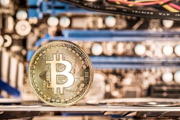Shiny physical bitcoins and record-keeping equipment. Mining farm.