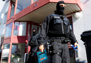 German police, which also involved Germany's GSG9 special operations police unit, raid sites across Germany
