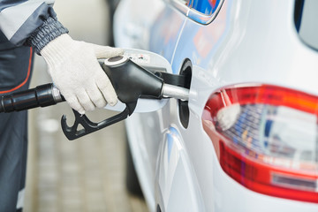 Fuelling diesel fuel into automobile at filling station