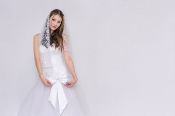 beautiful bride in white wedding dress in different poses on white backgrounds shows different emotions