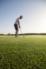 Golf player on the green with copy space
