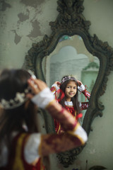 A beautiful cute little girl in a medieval historical costume
