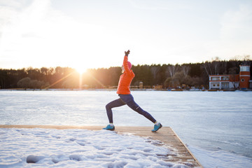 Photo of sports woman on morning exercise in winter