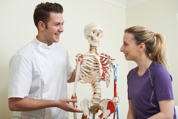 Female Patient In Consultation With Osteopath