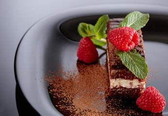 Chocolate cake with raspberry and mint .
