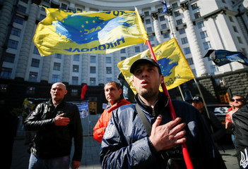 Drivers block the Ukrainian government headquarters during a protest against fuel price increases in central Kiev