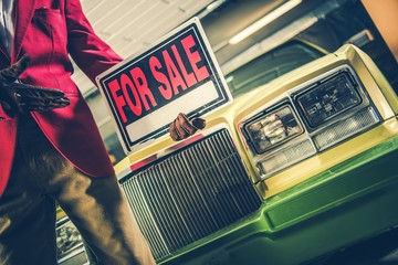 Car For Sale Sign in a Hand