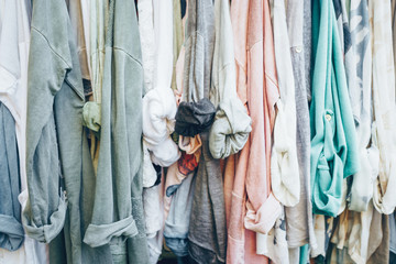 Pastel background with jersey woman's clothes in shop.