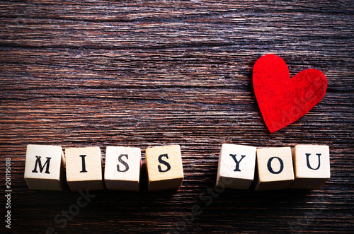 Heart Shaped Chewing Candies And Words Miss You On Cubes Wooden