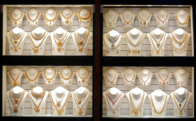 Gold necklaces are on display inside a jewellery showroom on the occasion of Akshaya Tritiya, a major gold buying festival, in Mumbai