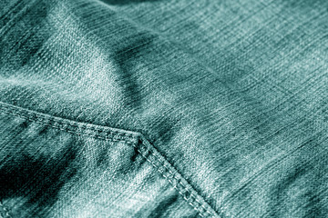 Jeans with pocket with blur effect in cyan color.