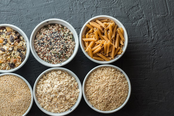 Bowls with whole grain carbohydrates, oats, brown rice, seeds, quinoa and whole grain pasta. Whole grain cereals