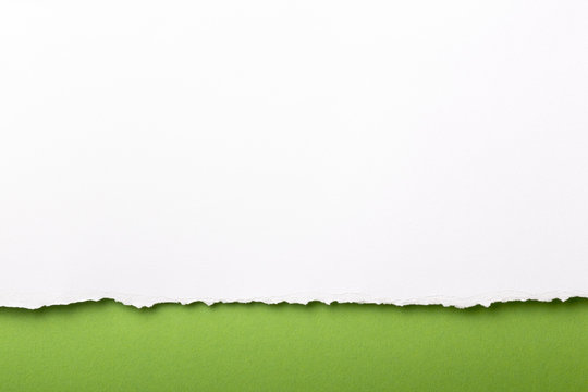 Ripped white paper with colored background with space for text