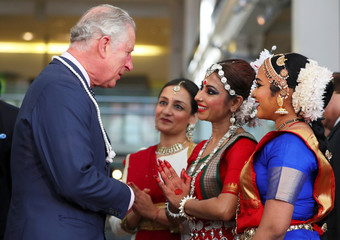 Britain's Prince Charles greets dancers during a visit to the science museum with India's Prime Minister Narendra Modi in London