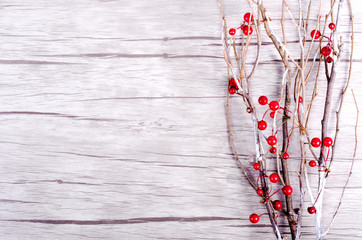 Branch with berries on wooden background. Toned effect. Copy space