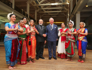 Britain's Prince Charles and India's Prime Minister Narendra Modi pose with dancers during a visit to the science museum in London