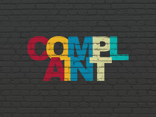Law concept: Painted multicolor text Complaint on Black Brick wall background