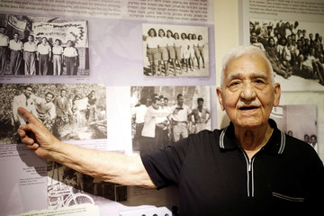 Zevulun Hareli, 90, who immigrated from Iraq to Israel in 1949, points at photos on display at the Babylonian Jewry Heritage Center in Or Yehuda