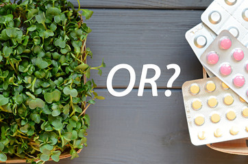 Natural micro greens or pills. Healthcare concept on a wooden table
