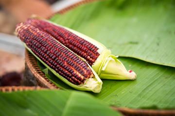 purple corn on panana leaf at the market