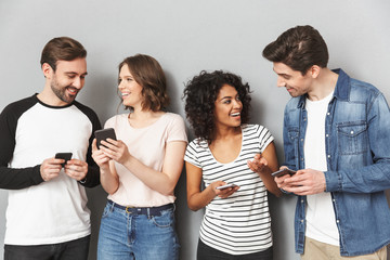 Emotional group of friends using mobile phones chatting.