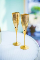 Two gold wedding glasses for champagne