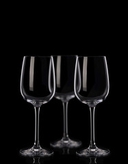 Three wine glasses on black background