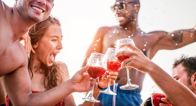 Happy friends drinking sangria wine at exclusive boat party