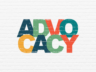 Law concept: Painted multicolor text Advocacy on White Brick wall background