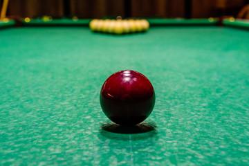 Red ball on the green cloth. Russian billiard