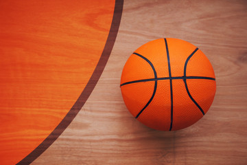 Basketball ball on court floor